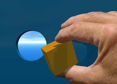 Hand trying to put Square peg into a round hole